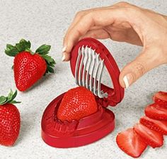 Special strawberry slicer? Use your egg slicer. Works nicely + it's larger for large berries!!