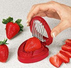 Special strawberry slicer? Use your egg slicer. Works nicely + it's larger for large berries!!