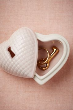 Hearted Ring Box - Tuck rings inside a keepsake ceramic box, fitted with an old-fashioned keyhole and tiny key, before, during, or after the ceremony to keep them safe. from BHLDN