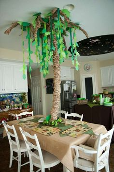Love the tree. Very simple table setting but it sets the mood.