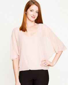 Chiffon poncho sleeves create a breezy and elegant silhouette to dress up or down. #blush #pastel