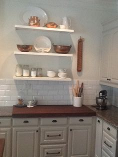 Baking center with open shelving and walnut countertop