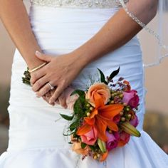 A Lovely Orange & Blue Sea Themed Wedding at The White Room in St. Augustine Florida.
