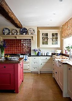 Brabourne Farm: Kitchens--not sure about the red tiles but like the island and layout