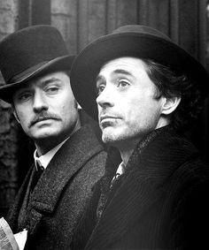 Jude Law as Dr. John Watson and Robert Downey Jr. as Sherlock Holmes.