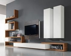 47 Amazing Wall Storage Items For Your Contemporary Living Room. Floating wall storage is a mix of practical storage and home décor fashion where the storage unit is fixed to […] Living Room Wall Units, Living Room Tv Unit Designs, Living Room Modern, Interior Design Living Room, Contemporary Living Room Designs, Modern Contemporary, Contemporary Tv Units, Cozy Living, Modern Rustic