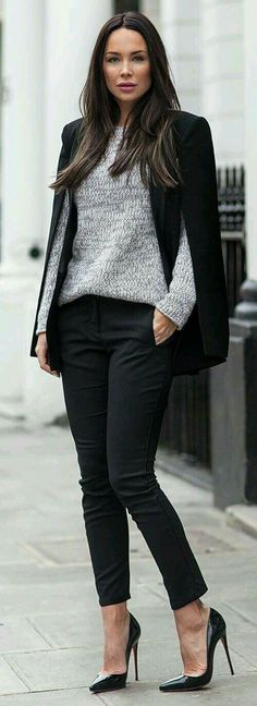 Black sleek pants, oversized grey sweater.