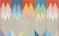 color wave. Handwoven dhurrie rug100% recycled cottonVacuum regularlyProfessional cleaning recommendedMade in India.