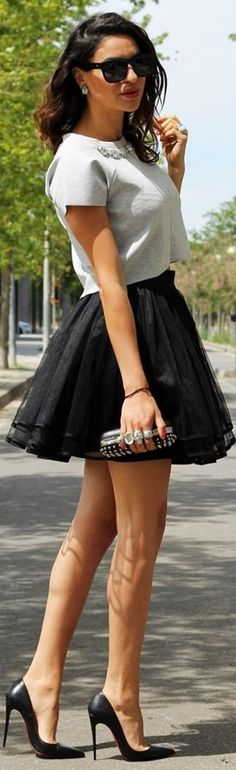 Best Street Style Inspiration - Black pleated skirt top gray short sleeved blouse and clutch and black pumps