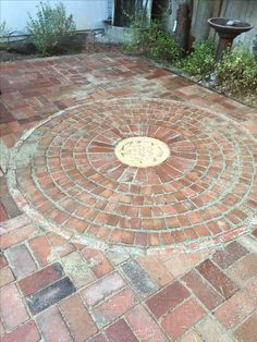 Brick mandala with Tudor Rose step stone at center