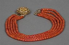 A five string coral bead necklace Set with a pierced gold clasp. Approxima