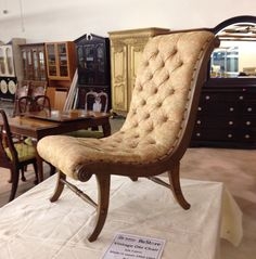 A Japanese Obi Chair, donated to the ReStore. These were upholstered with the same silk that was used to make Obis. Many were purchased by GIs after WWII and shipped home to the United States.