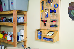 Keeping your workspace organized is always a challenge, but small tools can be especially challenging. This wall-mounted storage center gives all those tools a home, with a pegboard hanging area and storage shelves. Plus, there's a handy desk surface to hold a tablet or notes while you work.