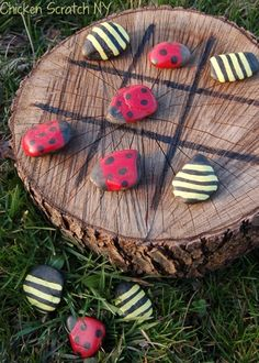 Paint ladybugs and bees on some smooth river rocks, using a tree stump as the board to create a fun outside tic tac toe game for the children.