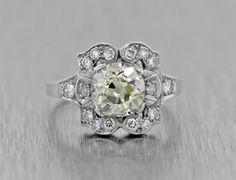 Antique Art Deco 1920s Platinum 1.85ctw Old Mine Diamond Engagement Ring Carat Weight 1.51ctw Color K-L Clarity SI3 Cut Old Mine Cut Measurements 6.80 x 6.77 x 4.54mm  Accent Gemstone Details Accent Stone(s) 16 natural diamonds  Carat Weight 0.34ctw  Color / Clarity G-H / VS2-SI2