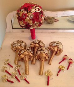 Custom Brooch Bouquet Bridal Package Vintage Bridal Bouquet in elegant red & gold. Bridesmaids bouquets in gold. Groom & groomsmen boutonnieres in red & gold. Order yours today!