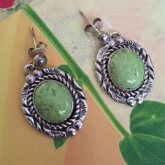 """Native American Earrings Pre owned vintage earrings. Native American. Length 1"""". Hallmark stamp """"NE Sterling"""". stone looks like a lift green color with brown specs. Native American Jewelry Earrings"""