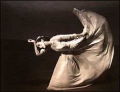 Martha Graham, by Yousuf Karsh  The photograph creates the feeling that her back leg is moving up while the rest of her body is still. I like how her arm, and hand resting against her head mimic the same shape coming from her leg movement.