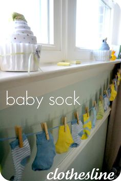 22 Cute and Low Cost DIY Decorating Ideas for Baby Shower Party: Baby Socks on clothes line. Cute decor, plus baby will be all set in socks at the end of the party :) Deco Baby Shower, Shower Bebe, Baby Shower Favors, Baby Favors, Baby Shower Clothesline, Baby Shower Garland, Shower Gifts, Baby Sprinkle Shower, Baby Shower Banners