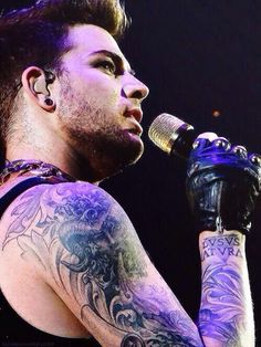 He has the coolest tatts