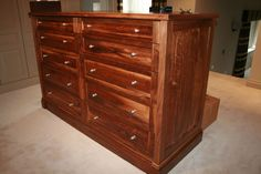 """This piece is a fantastic example of the beautiful variance's in the colour of natural walnut. These drawers are the centre peice of a dressing room comprised of tall wardrobes painted in a lovely soft colour similar to the Farrow and Ball colour """"Elephants Breath"""" which compliments the Walnut perfectly"""