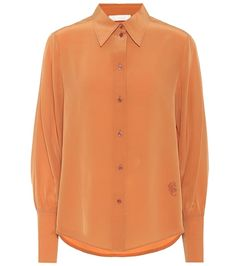 """Add depth to your fall looks with this silk crêpe de chine shirt from Chloé, which comes in a rich shade orange that the label poetically calls """"Sunburn Brown. Satin Top, Silk Satin, Chloe Clothing, Leopard Jacket, Leopard Print Top, Shirt Blouses, Shirts, Silk Crepe, Clothes"""