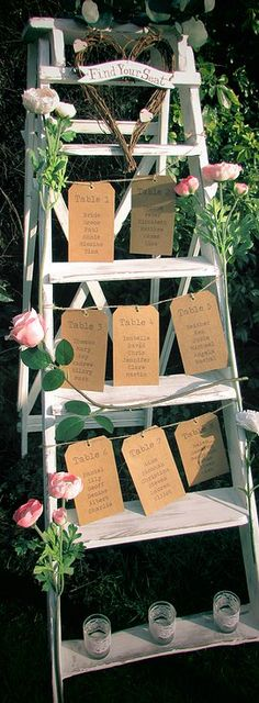 Step Ladder Table Plan to hire - Created using a large shabby-chic ladder and combined with rustic luggage labels, twine and our 'find your seat' wicker heart.