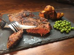 Smokey chilli and coffee marinated ribeye steak with sauteed potatoes and minted garden peas