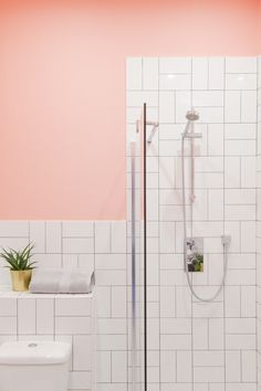 This pink bathroom with gold accents was a big hit! The simple white subway tiles are laid in an interesting pattern to create a fresh new look. Gold Bathroom, Small Bathroom, Bathroom Hacks, White Subway Tiles, Apartment Projects, Flooring Options, Beautiful Bathrooms, Vinyl Flooring, Home Staging