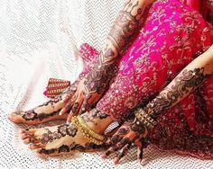 Beautiful Henna Tattoo one of Brides hands and feet.