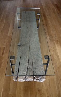 Reclaimed wood, rough iron, and tempered glass