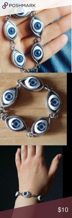 "Evil eye bracelet (2 left) Price firm unless bundled. Synthetic materials. Statement. Silver tone. 5 blue eyes. Approximately 6"" long with 2"" extender and lobster clasp. No pp no trades. This item available for wholesale. 5 Jewelry Bracelets"