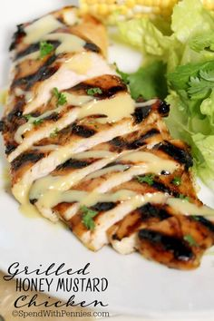 Easy Grilled Honey Mustard Chicken is tender & juicy... totally irresistible! This can be grilled (or baked) for the perfect summer meal or salad topper!