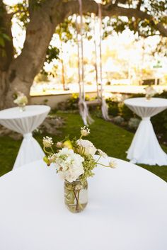 we changed the cocktail tables to white table linens with saffron sashes - and of course they will each have a mason jar!