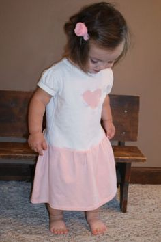 How to Make a T Shirt Dress.. easy and might be a cute way to use dollar store tshirts or even to remake some that are lightly used into something special.