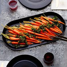 Dark honeys, like buckwheat, bring a touch of earthy sweetness to these lightly glazed beauties. The gremolata, made with the frilly green carrot tops, make a delicious and pretty finishing touch while adding to your #wasteless repertoire. If bunched carrots with tops aren't available, use parsley for the gremolata instead.