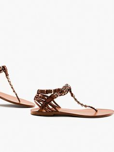 $250.00 The power to set trends with every step. Sandal in nappa-finish cowhide with a metal and leather chain detail, plaited straps with metallic logo buckles, and a leather insole and sole. It includes special packaging for this limited edition collection.