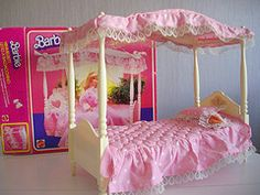 Barbie Canopy Bed...I LOVED Barbie! My grandmother collected her; had everyone from the first released until the Bob Mackey's. She died the year after Titanic was released...1998? Don't remember. But she had every doll released from the start of Barbie and all of the Bob Mackey's. A lot of the houses, furniture, etc... also.