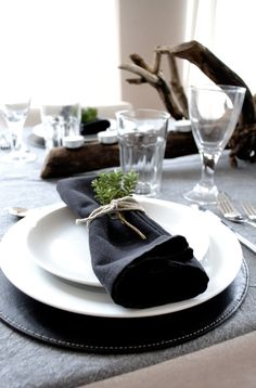 Showing you my idea of a festive yet simple black and white table setting for Christmas with some rustic natural elements.