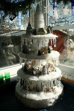 display a putz Christmas village vertically with cakestands