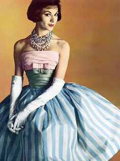 Pierre Balmain 1960 fashion vintage style strapless dress pink shelf bow blue white stripe full skirt fit flare party cocktail gloves necklace hair model magazine color photo designer couture.