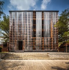 otherwise being completely exposed, bangkok project studio wrapped 'wine ayutthaya's' timber grid facade with strips of Pavilion Architecture, Modern Architecture House, Interior Architecture, Interior And Exterior, Wine House, Bar Design Awards, Facade Design, Bangkok, Building
