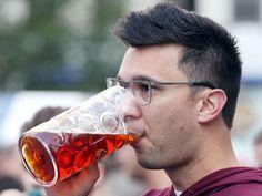 Your guide to Oktoberfest season. Photo: Alex Schulze, of West Chester, enjoys a beer at Oktoberfest Zinzinnati last year. The Enquirer/Patrick Reddy