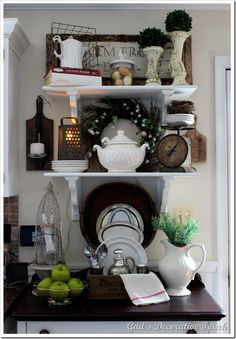 so many neat ideas in this picture...i especially like the antique cutting board/ladle candle holder that she made...she is soooo creative!