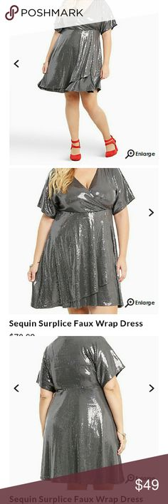 Torrid SEQUIN WRAP DRESS PLUS SIZE DETAILS Disco babes, dust off your old vinyls, this dress needs to be taken for a spin on the dance floor. Detailed with brighter-than-the-disco-ball gunmetal sequins all over; if the shimmery sequins don't get you noticed, the bust-boosting surplice neckline and tummy-concealing faux wrap skirt certainly will. Fully lined. torrid Dresses