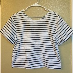J.Crew striped crop top Brand new, black and white crop top, size small but it's a loose fitting so will fit up to a size medium. 97% cotton, 3% elastane, zippered back.  NO TRADES, use offer feature to negotiate J. Crew Tops Crop Tops