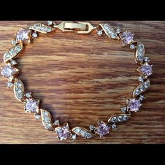 "Swarovski Pink Crystal 14KT GF Bracelet This would be a amazing gift. It is NWOT. It is 18KT gold filled with Swarovski crystals. 7"" long. This picture doesn't do it justice. Just gorgeous. Firm on price. Gulicx Jewelry Bracelets"