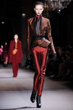 """There is always a a certain magic in the air, an enigmatic atmosphere that sets the tone of Haider Ackermann shows. This season's défilé held in the sumptuous """"Salons de l'Hôtel de Ville"""" w..."""