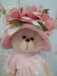 teddy bear tea...with her pretty bonnet