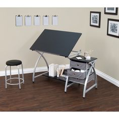 The Comet Center with Stool provides a comfortable workspace and keeps your supplies easily accessible.
